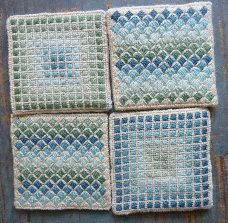 scruffy bunch of needlepoint coasters