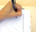 tracing a design onto wood block