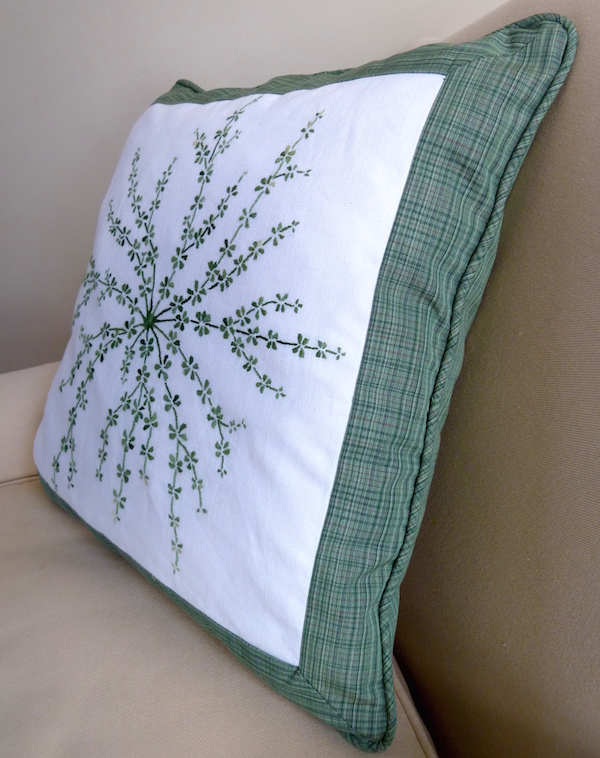 side view embroidered pillow