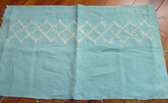 overview lattice whitework on turquoise