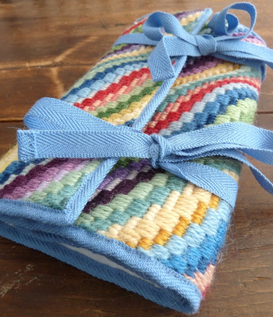 tied up needlepoint pocketbook