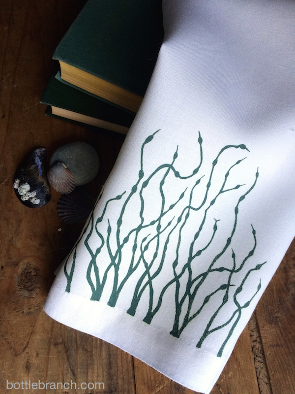 seaweed towel with books etc bottle branch