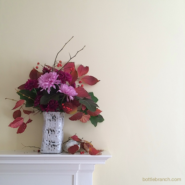 autumn arrangement with mums bottle branch blog