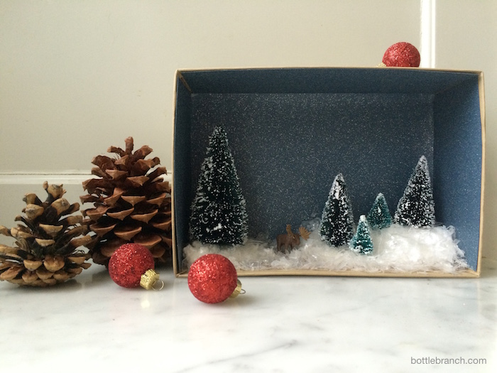 completed and styled winter vignette bottle branch blog