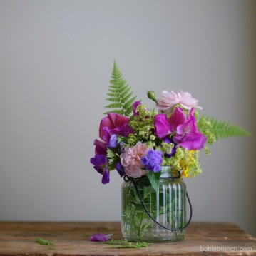 a bouquet of garden flowers from bottle branch