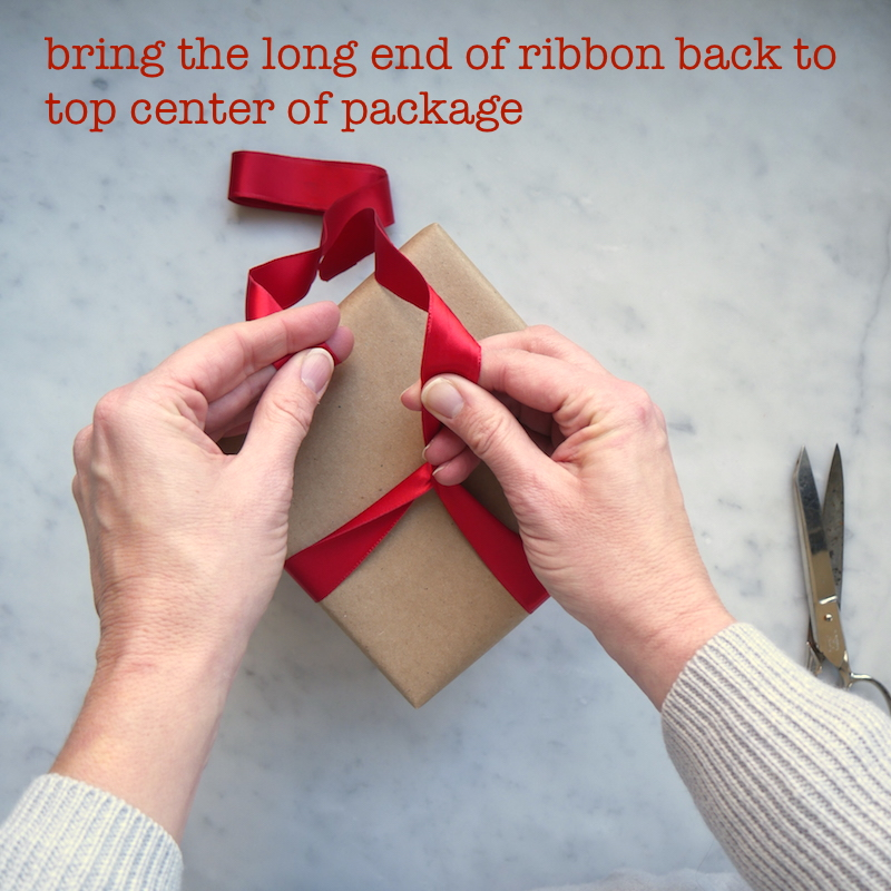 w24-bring-ribbon-back-up-to-center-text