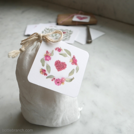 heart-gift-tag-white-muslin-bag-bottle-branch